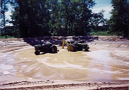 Jdbackhoediggingpond for Digging a koi pond